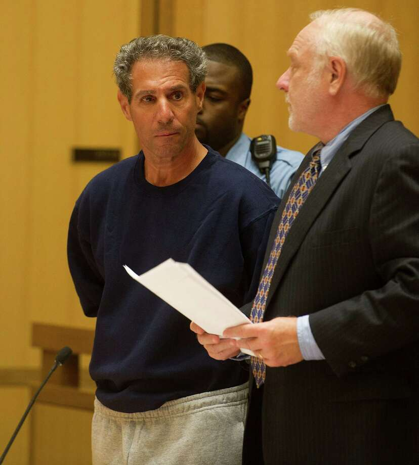 Michael DeMaio, 55, is arraigned on Wednesday, Sept. 11, 2013, on charges of criminal attempt at murder and first degree assault after his wife, Diane, was beaten with a baseball bat in their Greenwich, Conn., home Tuesday evening.  Representing DeMaio is public defender Howard Ehring. Photo: Lindsay Perry / Stamford Advocate