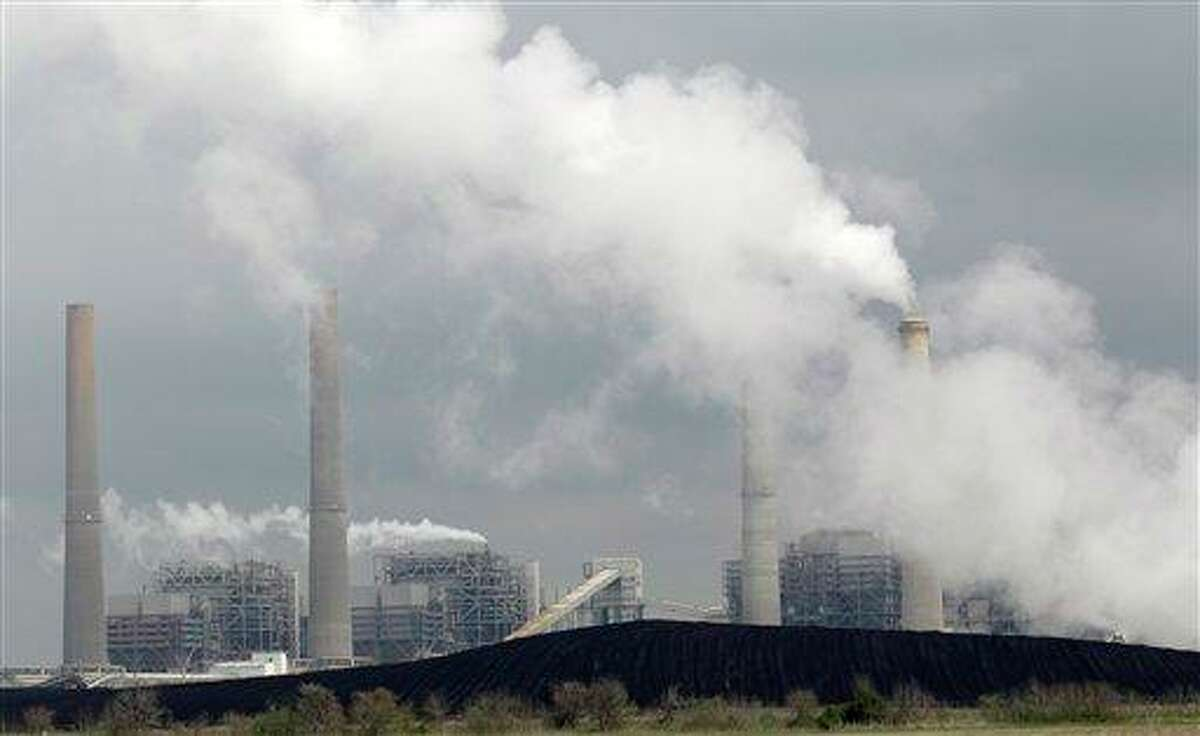 Piles of coal are shown at NRG Energy's W.A. Parish Electric Generating Station in March 2011, in Thompsons, Texas. The EPA has begun regulating mercury emissions from coal-fired power plants for the first time.