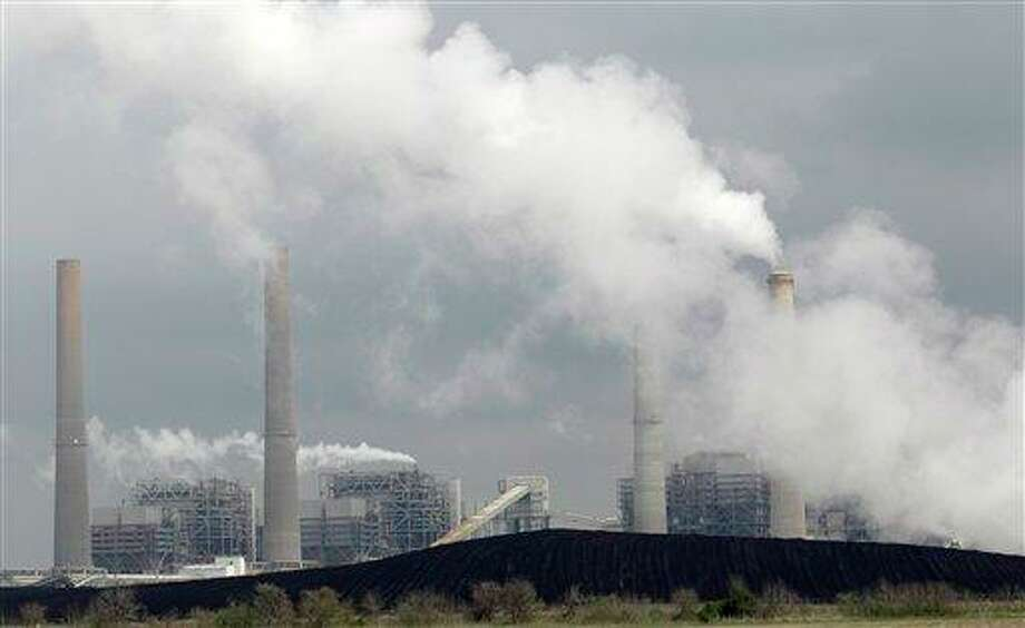 Piles of coal are shown at NRG Energy's W.A. Parish Electric Generating 