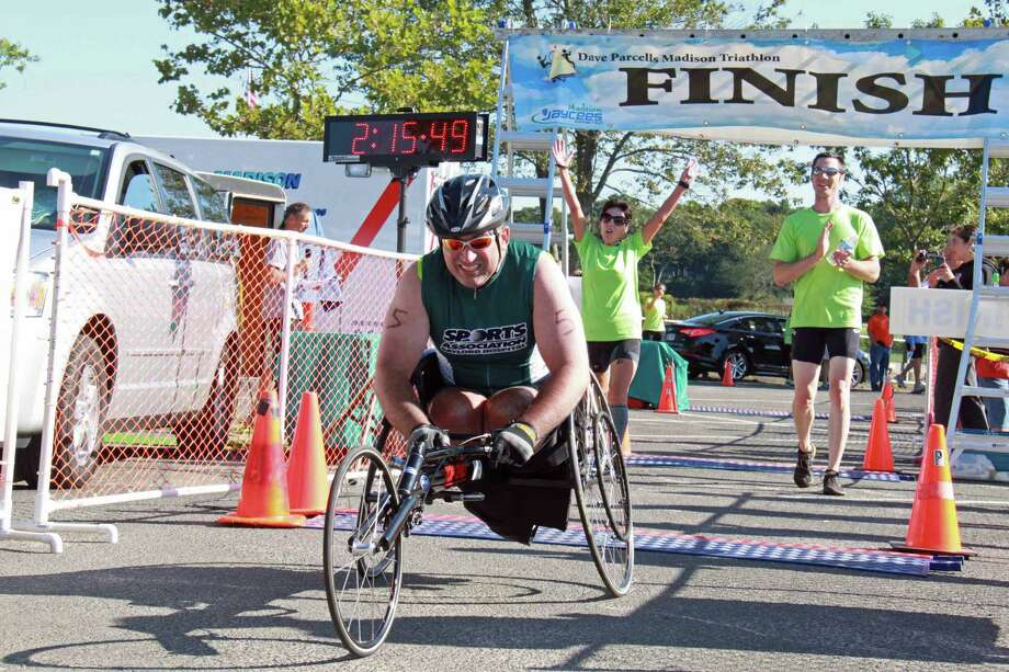 Mike Loura completed his first triathlon as a para-athlete on Saturday, Sept. 7 in Madison. Mira Lami and Steve Joly accompanied Loura throughout the race. Photo: Contributed