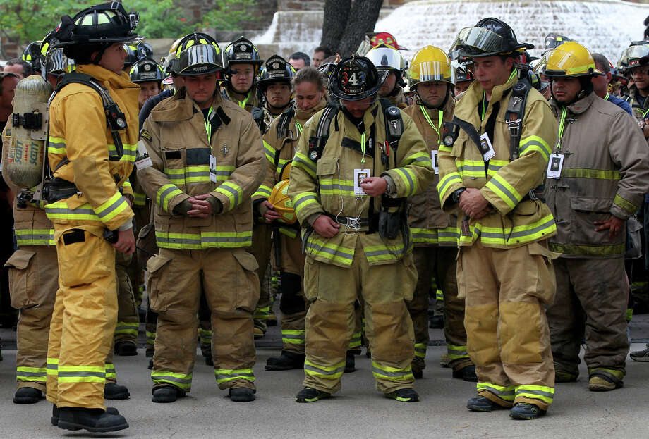 Firefighters pause before ascending the Tower of the Americas Wednesday September 11, 2013 during the San Antonio 110 9/11 Memorial Climb.  Photo: JOHN DAVENPORT, SAN ANTONIO EXPRESS-NEWS / ©San Antonio Express-News/Photo may be sold to the public
