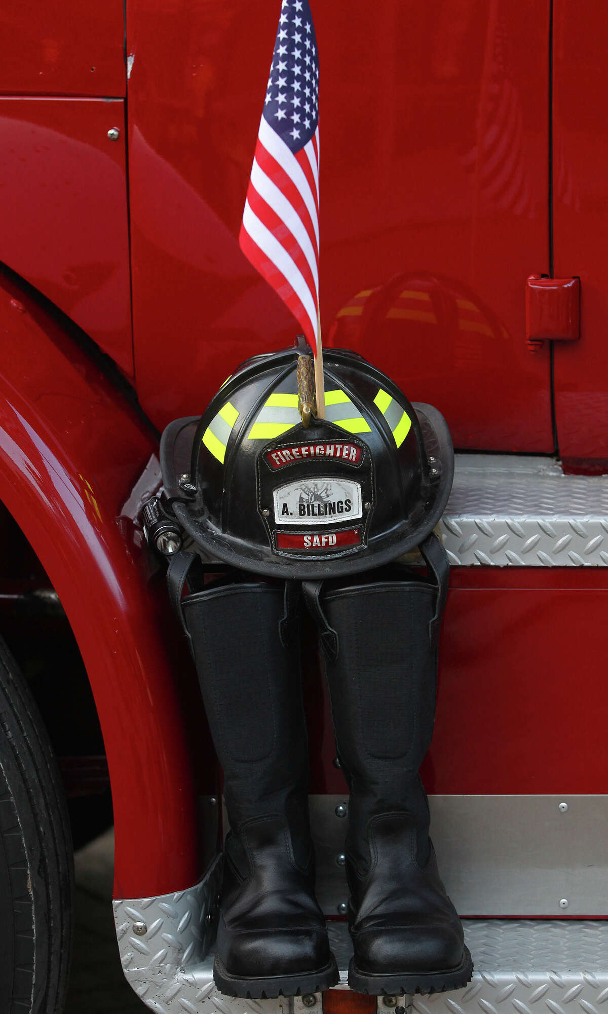 A pair of boots and a firefighter's head gear is displayed at the Tower of the Americas Wednesday September 11, 2013 during the San Antonio 110 9/11 Memorial Climb. Firefighters, law enforcement officers and others gathered there to honor and remember those who perished at the terrorist tragedies in New York, Pennsylvania and Washington 12 years ago. Most firefighters at the event made the climb in full bunker gear.