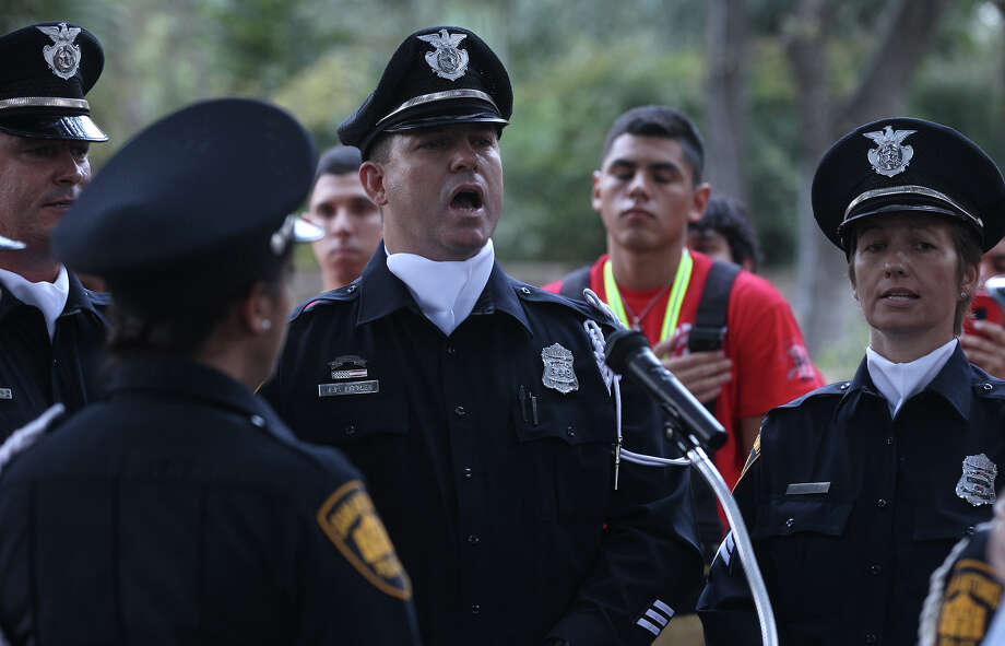 The San Antonio Police department choir sings the Nation Anthem Wednesday September 11, 2013 before the San Antonio 110 9/11 Memorial Climb.  Photo: JOHN DAVENPORT, SAN ANTONIO EXPRESS-NEWS / ©San Antonio Express-News/Photo may be sold to the public
