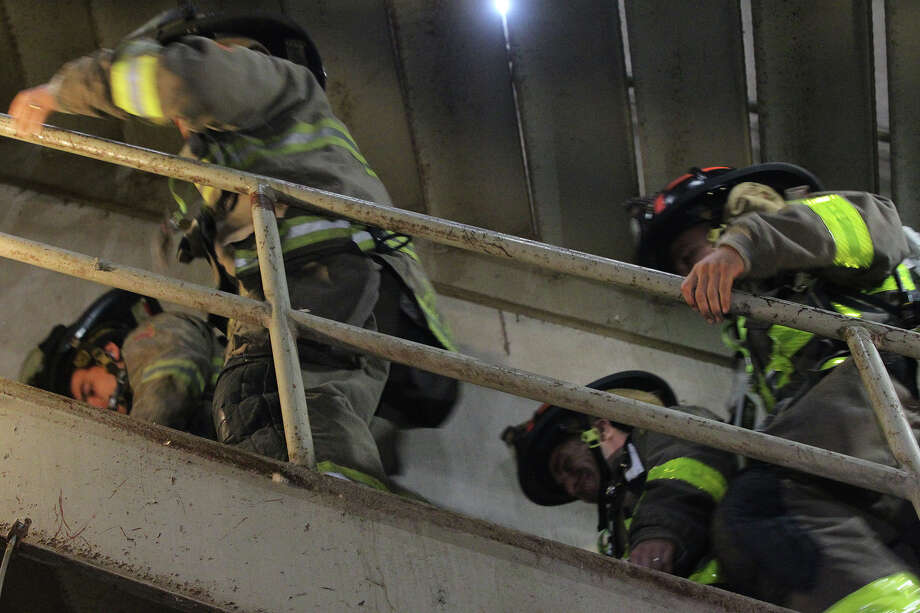 Firefighters ascend the stairwell at the Tower of the Americas Wednesday September 11, 2013 during the San Antonio 110 9/11 Memorial Climb.  Photo: JOHN DAVENPORT, SAN ANTONIO EXPRESS-NEWS / ©San Antonio Express-News/Photo may be sold to the public