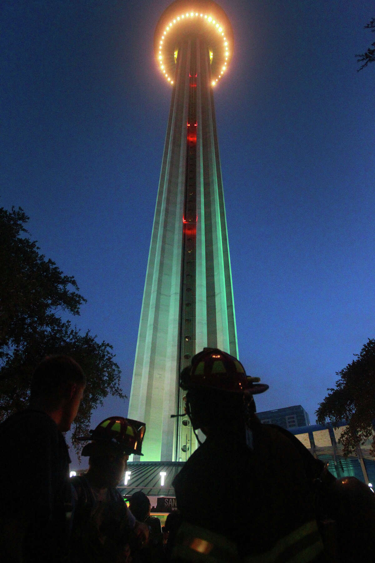 Firefighters gather at the bottom of the Tower of the Americas early Wednesday September 11, 2013 before the San Antonio 110 9/11 Memorial Climb.