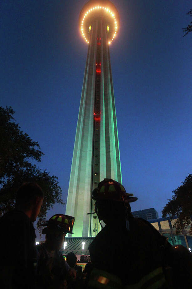 Firefighters gather at the bottom of the Tower of the Americas early Wednesday September 11, 2013 before the San Antonio 110 9/11 Memorial Climb. Photo: JOHN DAVENPORT, SAN ANTONIO EXPRESS-NEWS / ©San Antonio Express-News/Photo may be sold to the public