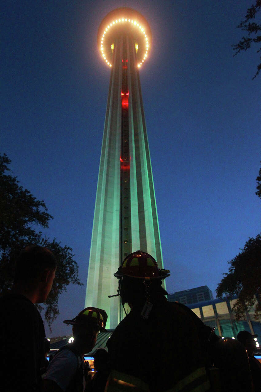 Firefighters gather at the bottom of the Tower of the Americas early Wednesday September 11, 2013 before the San Antonio 110 9/11 Memorial Climb. Firefighters, law enforcement officers and others gathered there to honor and remember those who perished at the terrorist tragedies in New York, Pennsylvania and Washington 12 years ago. Most firefighters at the event made the climb in full bunker gear.
