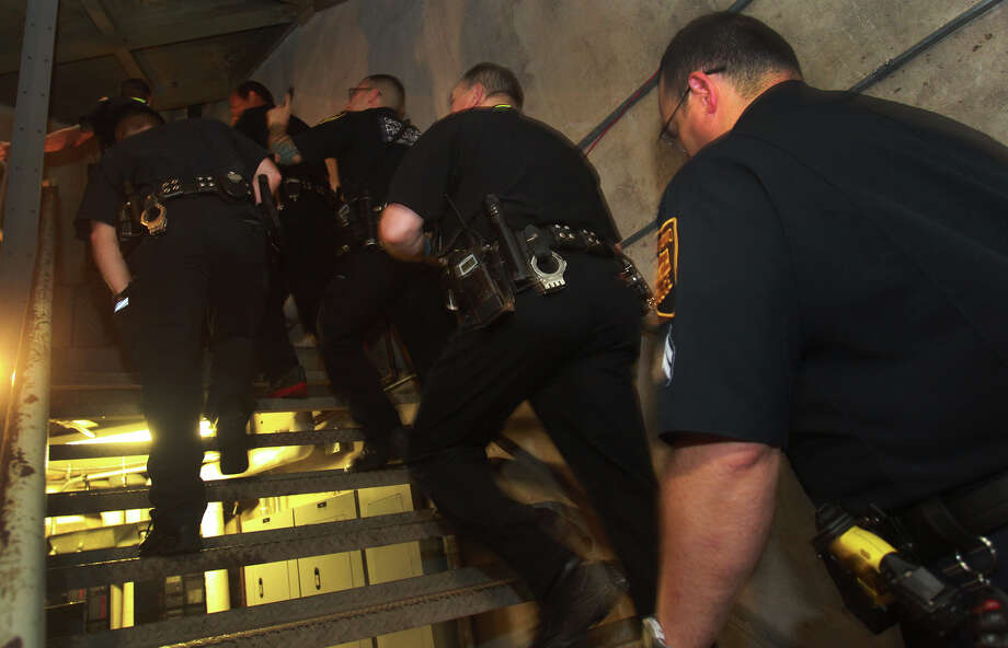Police officers ascend the stairwell at the Tower of the Americas Wednesday September 11, 2013 during the San Antonio 110 9/11 Memorial Climb.  Photo: JOHN DAVENPORT, SAN ANTONIO EXPRESS-NEWS / ©San Antonio Express-News/Photo may be sold to the public