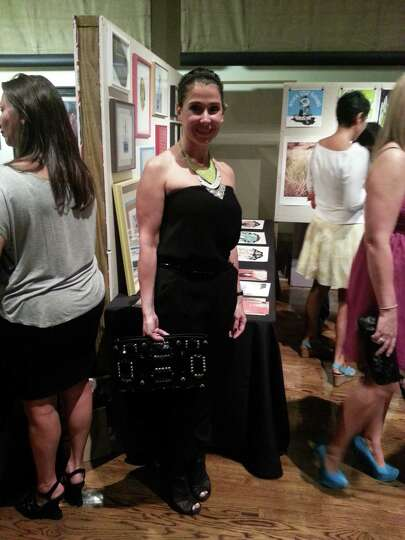 Patricia De Los Santos rocks a sleeveless black jumpsuit with platforms, layered rhinestone n
