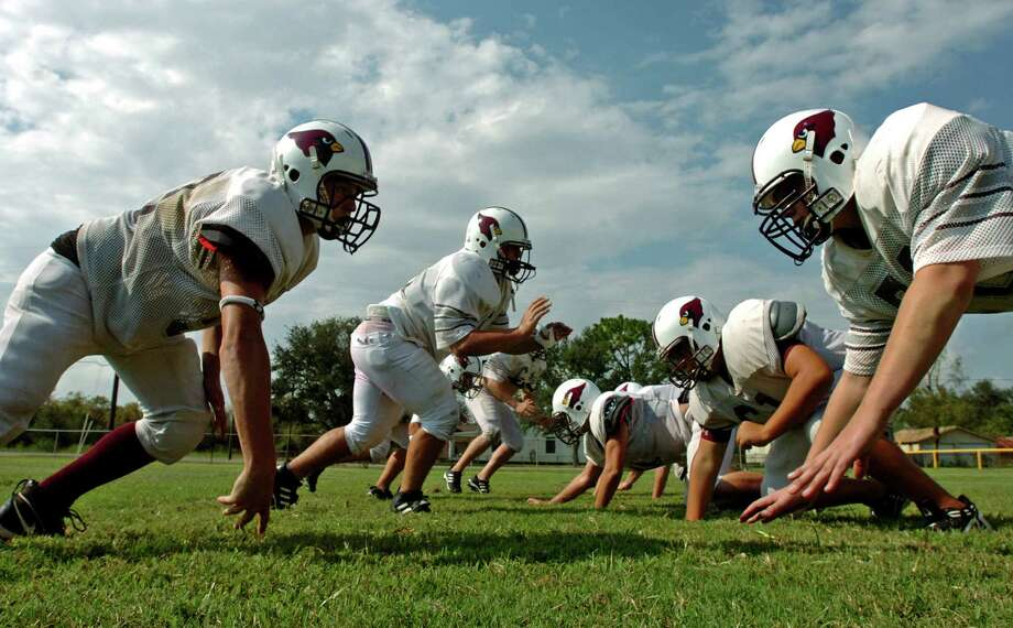 High Island School linemen work on plays during football practice at the school in High Island on Tuesday, Sept. 18, 2007. It was the first day the team could practice since Hurricane Humberto hit last week. The hurricane postponed the school's homecoming celebration originally planned for this week. Now, it's unlikely the team will play any games on their home field.  Mark M. Hancock / The Beaumont Enterprise Photo: Mark M. Hancock, Staff Photojournalist / The Beaumont Enterprise