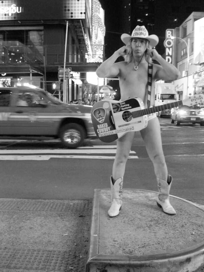 Photographer Lee Paine recently took her camera for a walk through New York City's Times Square, where she captured the Naked Cowboy . . . Photo: Contributed Photo