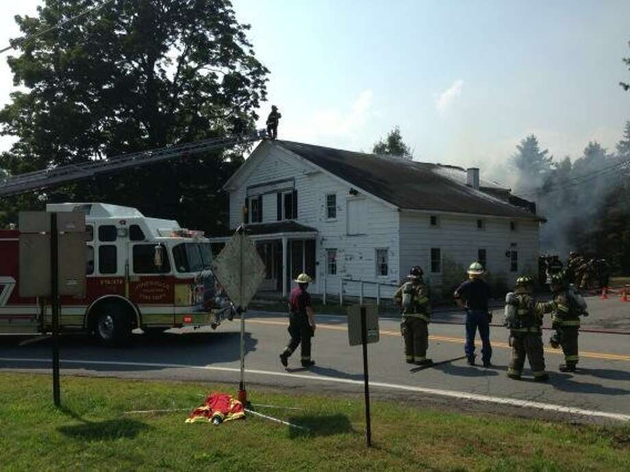 Firefighters battle a blaze that damaged a home on Riverview Road in Clifton Park on Wednesday, Sept. 11, 2013.ire on River ire Rd in Vishers Ferry