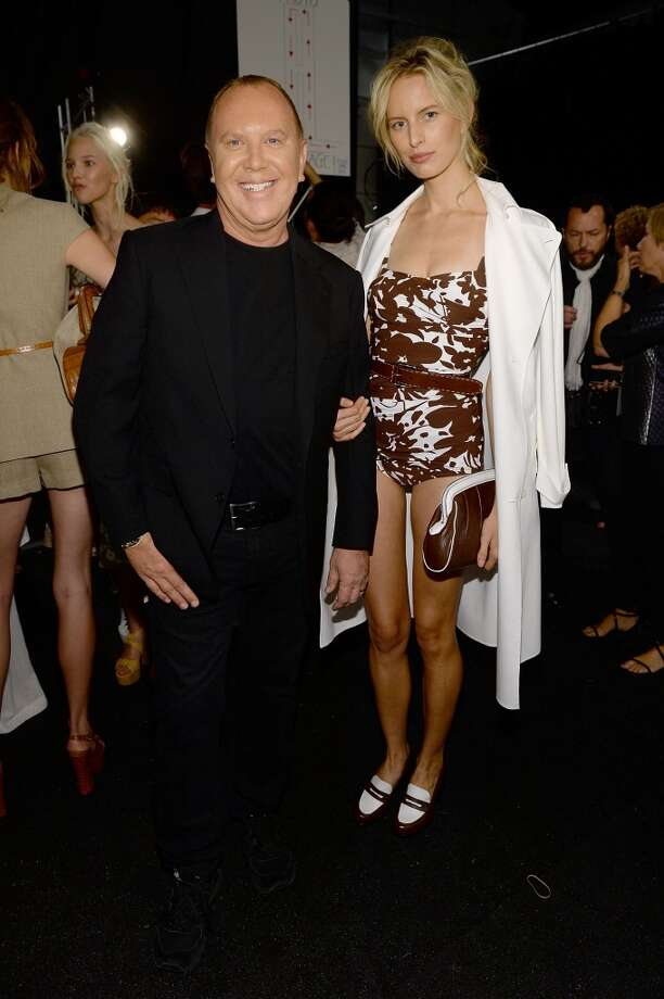 Designer Michael Kors (L) and model Karolina Kurkova pose backstage at the Michael Kors fashion show during Mercedes-Benz Fashion Week Spring 2014 at The Theatre at Lincoln Center on September 11, 2013 in New York City.  (Photo by Dimitrios Kambouris/Getty Images for Michael Kors) Photo: Dimitrios Kambouris, Getty Images For Michael Kors