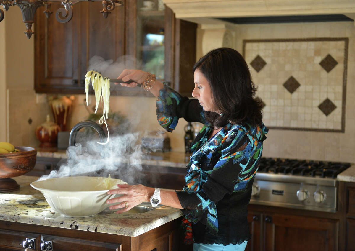 Rozanne Frazee prepares the pasta to be served prior to a recent dinner in the home of her and her husband Randy's home.