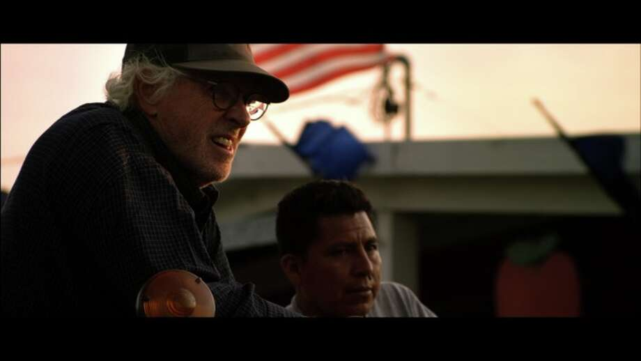 "A scene from ""Fighting for Freedom"": Bruce Dern as farmer Christian Dobbe, on tractor, with one of his Mexican employees standing close by.  (Loken Mann Productions)"