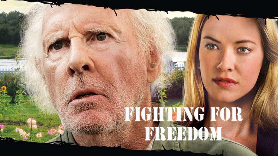 """Bruce Dern as fruit grower Christian Dobbe. Kristanna Loken as his daughter, Karen Dobbe, outside farmhouse in a scene from """"Fighting for Freedom"""" (Loken Mann Productions)"""