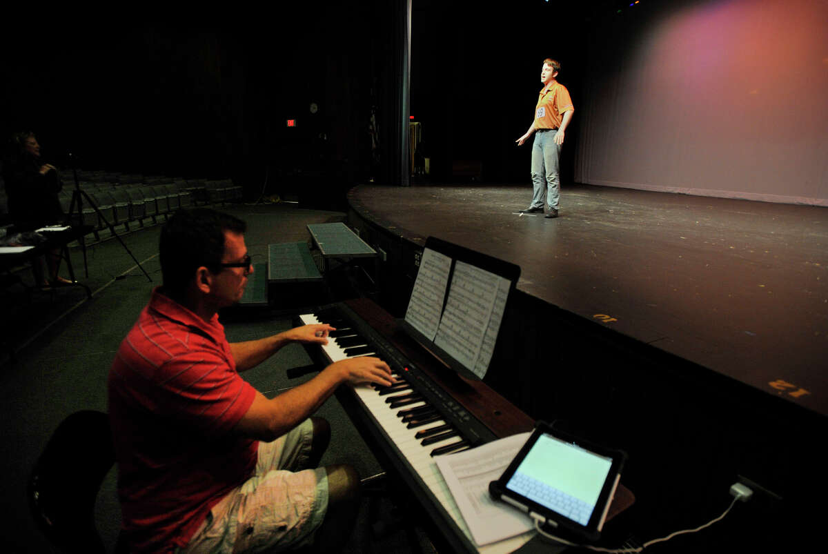 Roberto Corso performs on stage as musical director Christopher Rich plays the piano for him during the tryouts for The Stamford All-School Musical production of