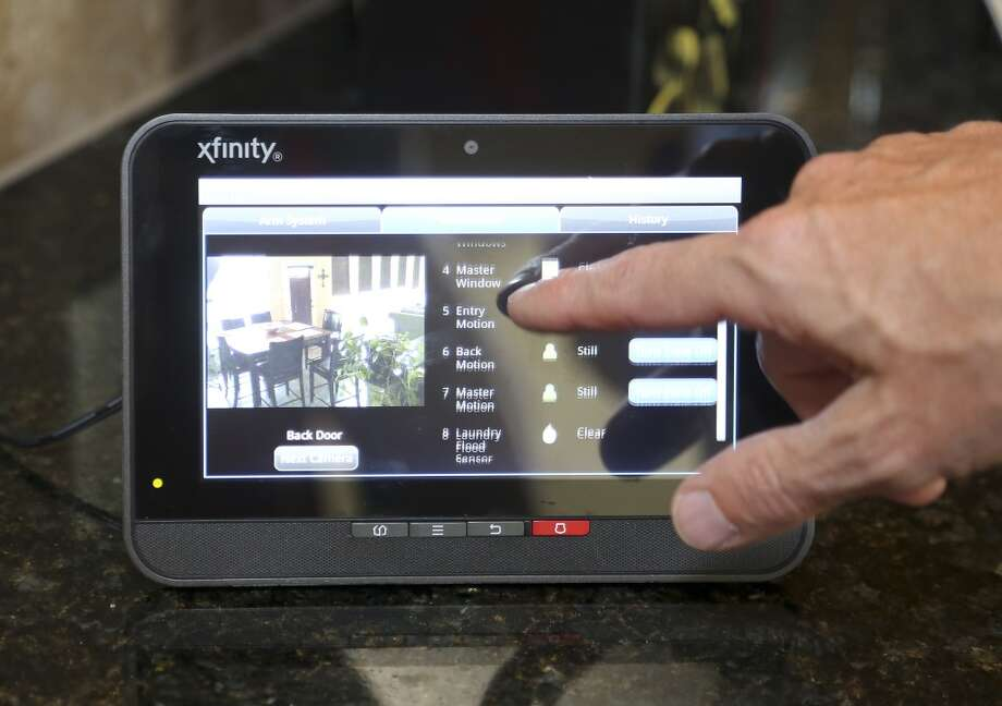 9/9//13: XFINITY Home demonstration. Mitch Bowling, senior vice president and general manager of New Business for Comcast Cable Corp., give a one-on-one demonstration of the next generation home security, control and energy management features that allow customers to stay connected to their home and family through the use of an interactive Web portal, mobile devices and the free Xfinity Home app. He will walk you through a suite of home control and remote energy management services that include lighting controls, digital thermostats, live video monitoring, custom text and e-mail alerts, remote arming and disarming capabilities, water and carbon monoxide sensors. Photo: Houston Chronicle