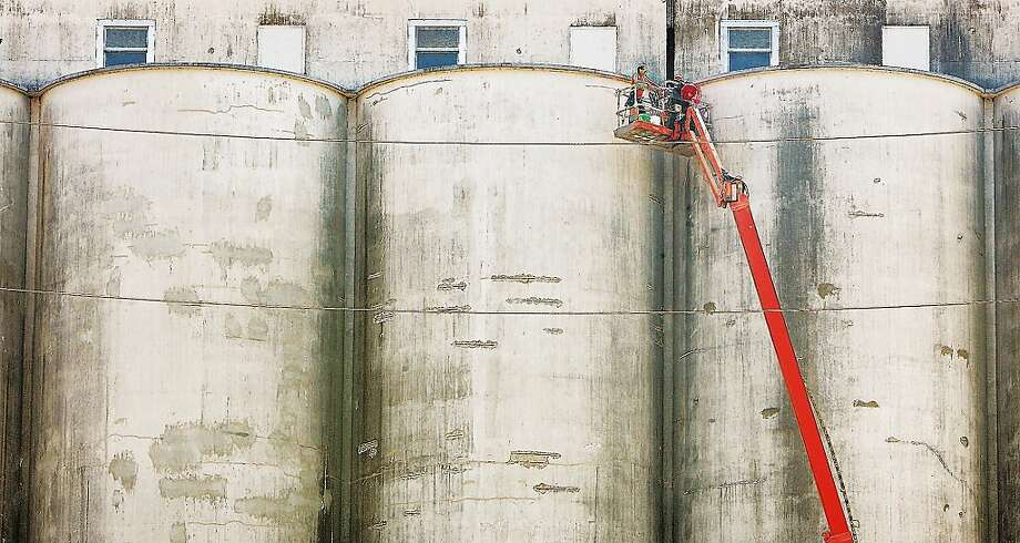 "See the scenic grain silos!""A worker gets a scenic view of Alton, Ill. at the top of the ConAgra Mill on West 