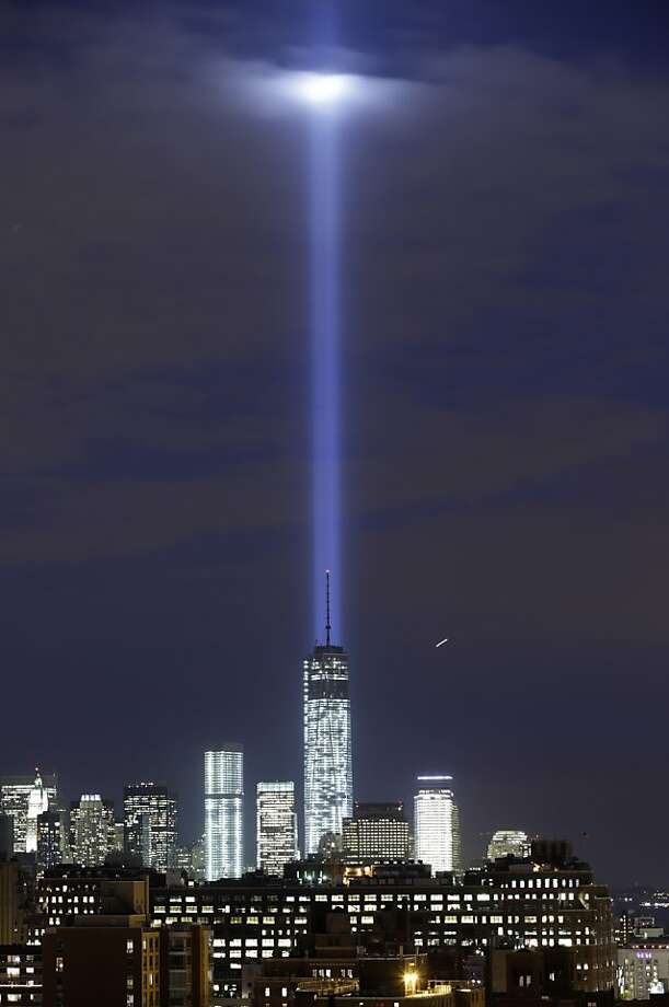 Pillar of light:A test of the twin beams of the Tribute in Light intersect with the still-under construction Tower One above lower 