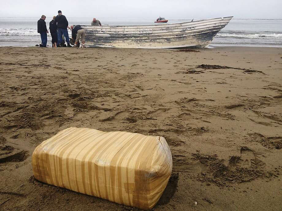 So far, no one has come forward to claim it: San Luis Obispo County Sheriff's Office investigators search a panga boat that was found on the beach at San Simeon State Park in Cambria, Calif. In the foreground is a bale of marijuana that was found aboard. Photo: San Luis Obispo County Sheriff's, Associated Press