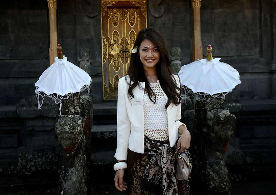 "Muslims vs. Miss World: Miss Japan Michiko Tanaka leaves Besakih temple in Bali after praying in a ceremony. Miss World organizers said it would be ""impossible"" to stage the finals in Bali amid radical Muslim protests. Photo: Sonny Tumbelaka, AFP/Getty Images"