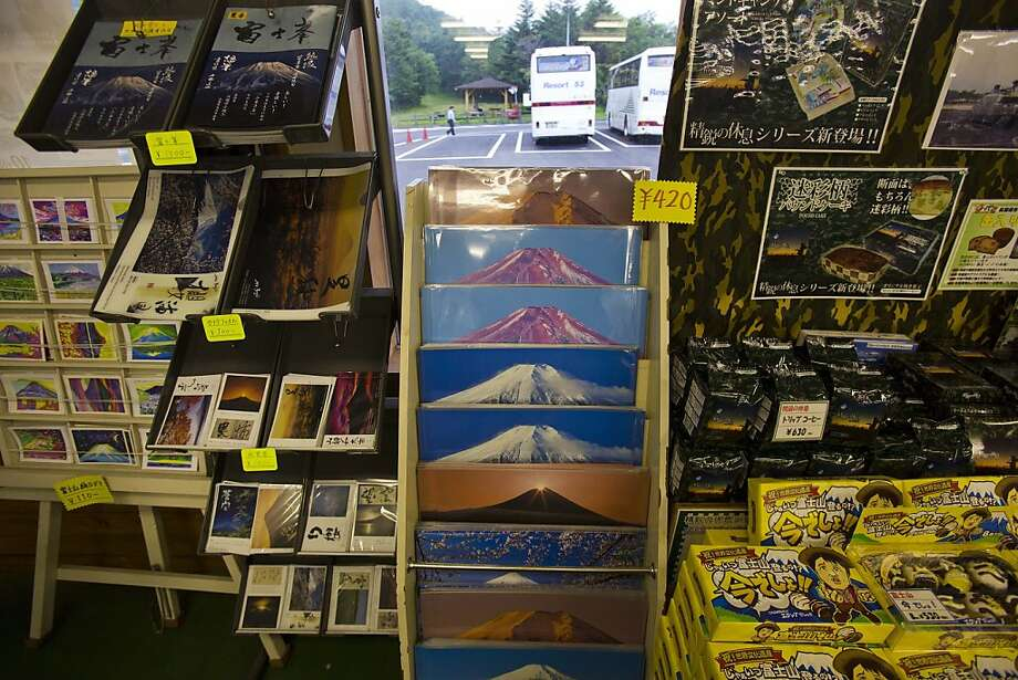 Mount Fuji souvenirs sit on shelves for sale at a shop at the base of the mountain in Japan on Aug. 29, 2013. Photo: David Guttenfelder, Associated Press