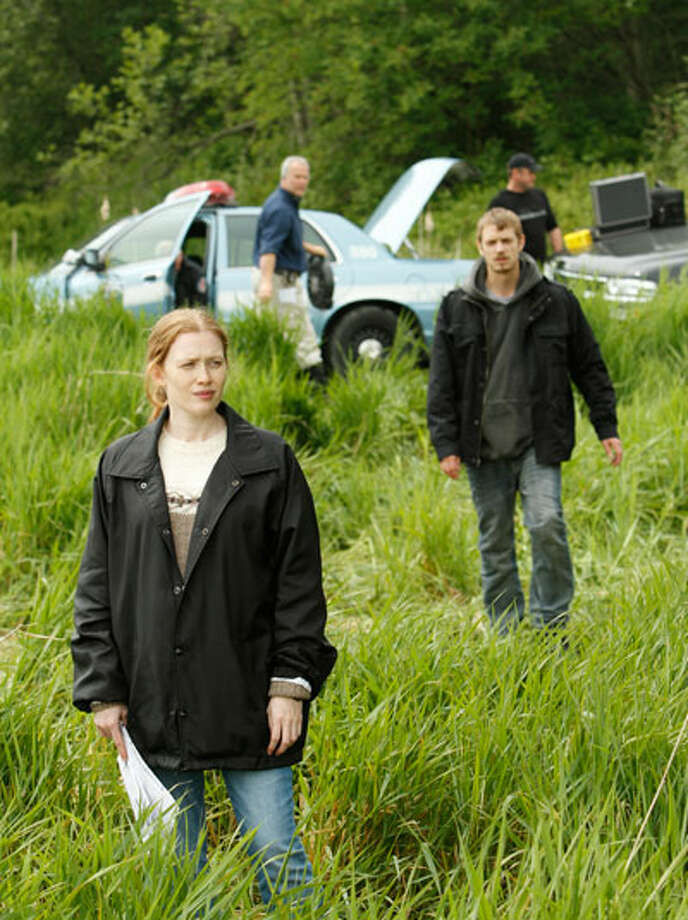 Not raining yet, but it will soon. Sarah Linden (Mireille Enos) and Stephen Holder (Joel Kinnaman) investigate the death of Rosie Larsen. Photo: Chris Large / Chris Large