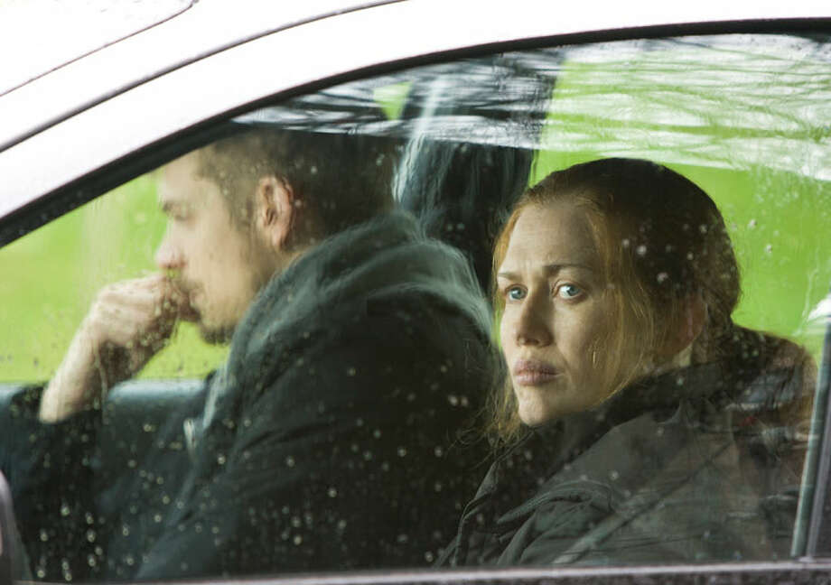 More rain. Stephen Holder (Joel Kinnaman) and Sarah Linden (Mireille Enos) are Seattle police detectives investigating the death of high-school student Rosie Larsen. Photo: Chris Large
