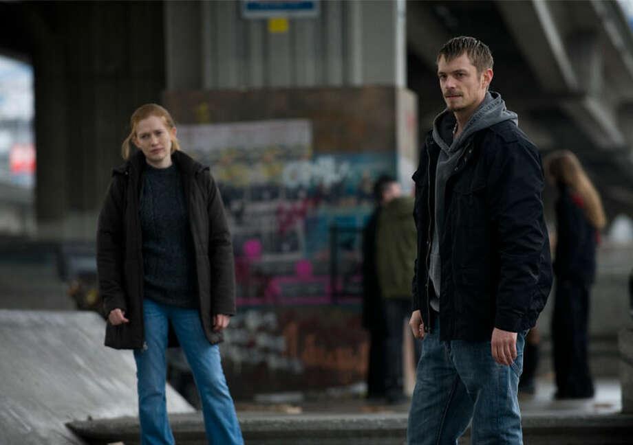 Stephen Holder (Joel Kinnaman) and Sarah Linden (Mireille Enos) investigate Rosie Larsen's death. Photo: Chris Large