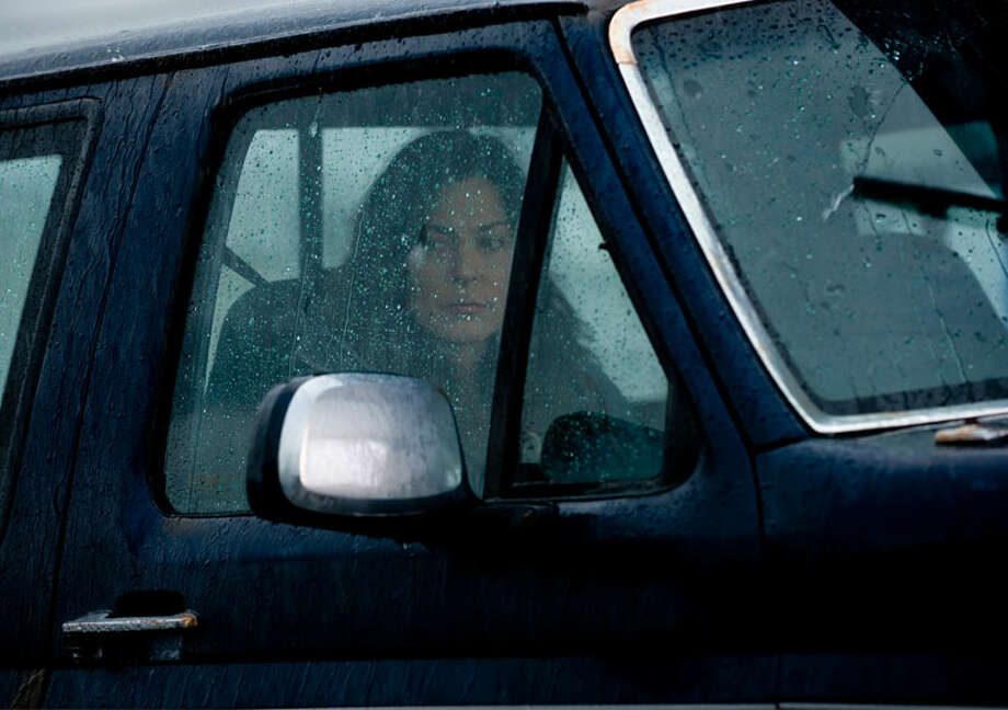 "Mitch Larsen (Michelle Forbes) waits for her husband in a scene from ""The Killing."" Photo: Chris Large"