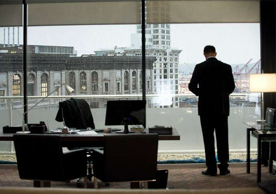 A familiar view of Seattle's Smith Tower. Darren Richmond (Billy Campbell) in his downtown office. Photo: Chris Large