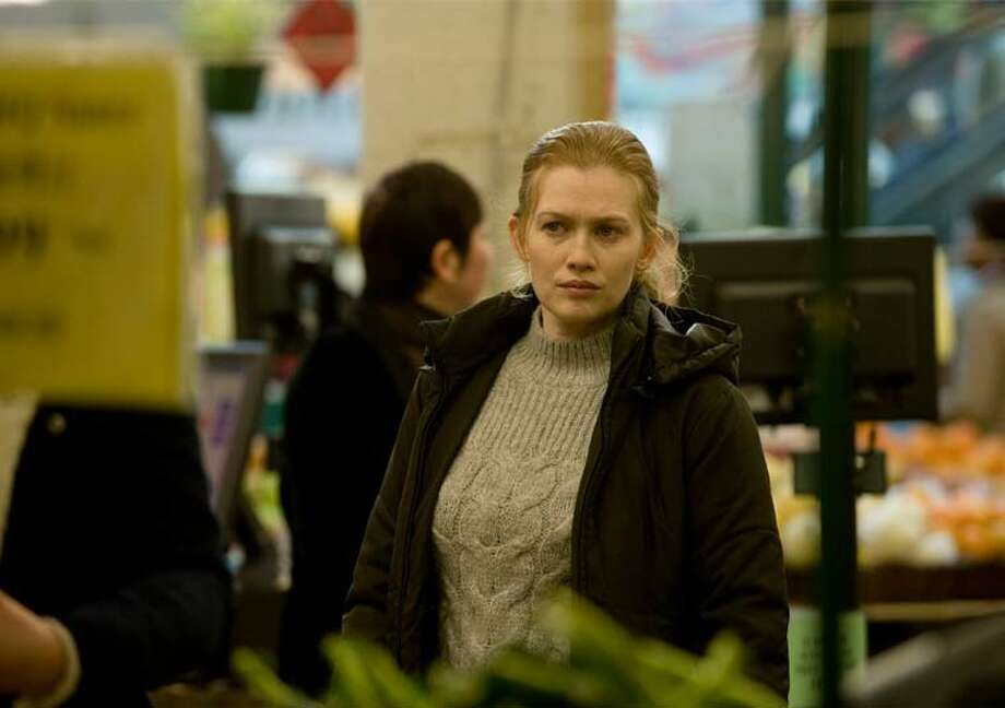 Fans say this scene, filmed in Vancouver, might be set at Pike Place Market. Sarah Linden (Mireille Enos) in Episode 9. Photo: Chris Large