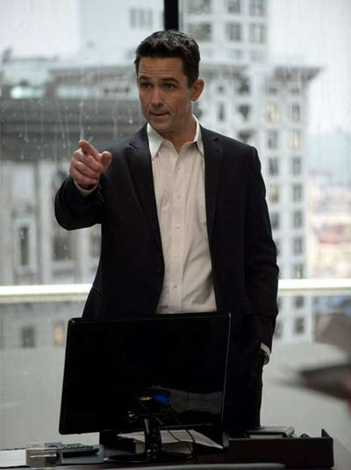 Another view of the Smith Tower. Darren Richmond (Billy Campbell) in Episode 8.