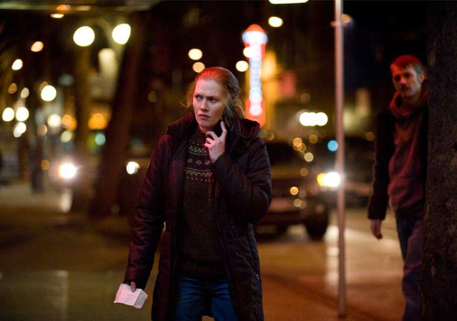 A downtown street at night. Sarah Linden (Mireille Enos) and Stephen Holder (Joel Kinnaman) investigate Rosie Larsen's death. Photo: Chris Large