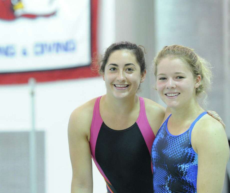 Greenwich High School swimmers Sara Rogers, left, and Kim Hill, both seniors, during practice at the Greenwich High School pool, Wednesday, Sept. 11, 2013. Photo: Bob Luckey / Greenwich Time
