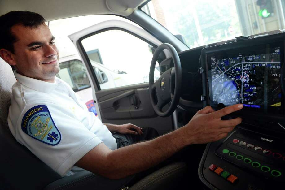 First responder Kevin Giasullo sits in the driver's seat of Stratford EMS' new truck which is equipped with an iPad based mobile data terminal using the program nexresponder Wednesday, September 11, 2013 at the station. Photo: Autumn Driscoll / Connecticut Post