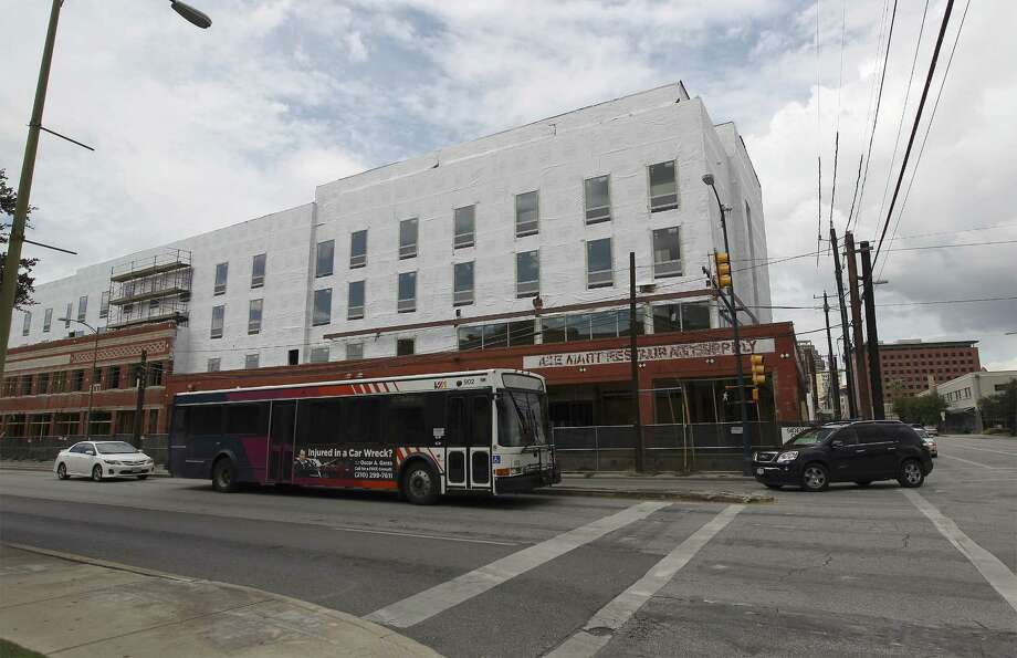 The intersection of César Chávez Boulevard and South Flores Street is along the 5-mile streetcar route proposed by VIA.  A reader calls for the proposal to be rejected. Photo: Kin Man Hui / San Antonio Express-News