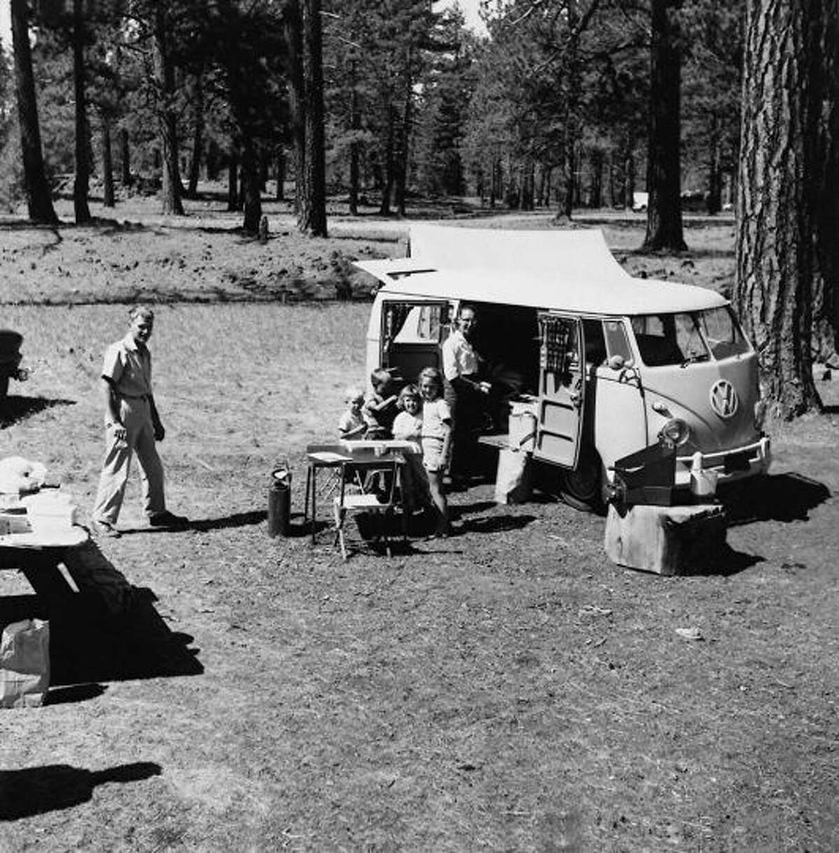 The Braden family camps with their 1960 Volkswagen van at Lassen National Forest, Calif., July 1964.