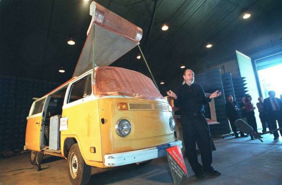 Electrical engineer David Schriner explains to the media how he was able to convert a Volkswagen camper bus into a portable radio frequency weapon May 1, 2001 at the Aberdeen Testing Facility in Maryland. The weapon, which uses commonly available materials, simulates a electromagnetic pulse similar to that of a nuclear weapon, which disables electrical and communictaions devices such as cell phones, computers, radios and medical monitors. The U.S. government funded the project to determine whether the technology poses a significant terrorist threat to the country. Photo: Greg Whitesell, Getty Images
