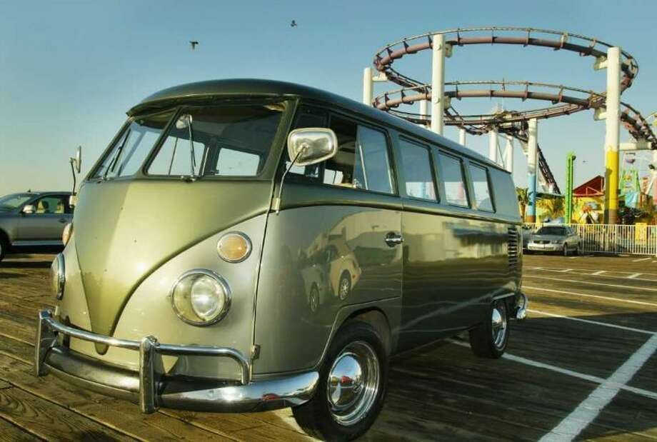 "A VW Bus awaits the Ceremonial Launch of Herbie and friends at the Santa Monica Pier on May 13, 2005 in Santa Monica, California. Over 53 vintage Volkswagens traveled along Pacific Coast Highway up to Ventura before they started their journey across the country together in celebration of Volkswagen's 50th anniversary and the release of Walt Disney Pictures ""Herbie Fully Loaded"". Photo: Christian Petersen, Getty Images"