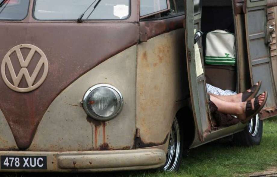 A VW van owner relaxes in his early Type 2 Volkswagen van at the 2009 Vanfest at the Three Counties Showground on September 13, 2009 in Malvern Wells, England. Photo: Matt Cardy, Getty Images
