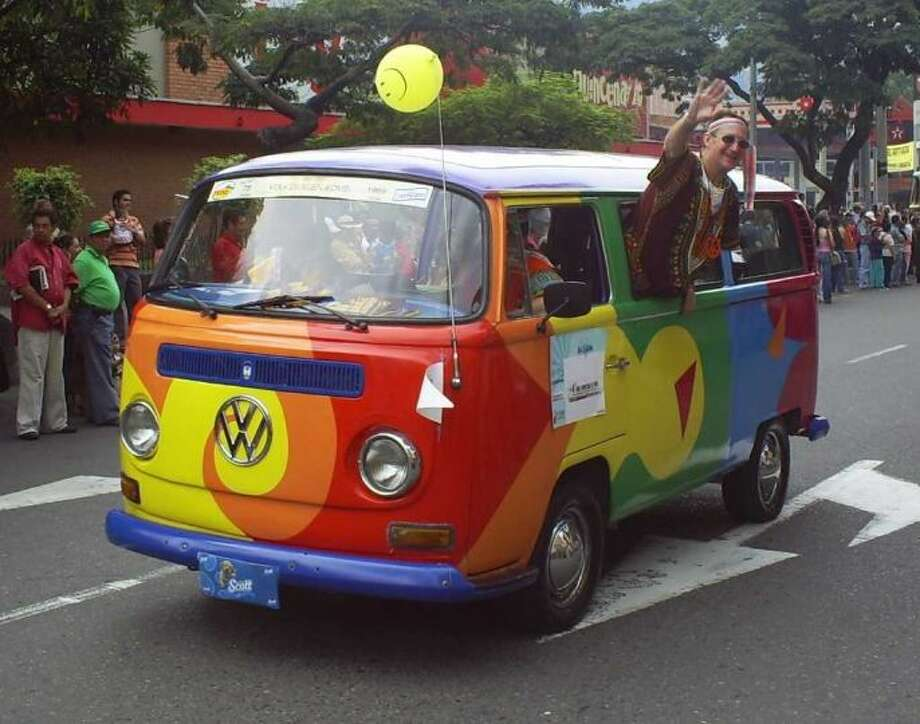 Participants in an antique-car show drive down a parade route April 8, 2007, in Medellin, Colombia. Photo: Sajor, Wikimedia Commons