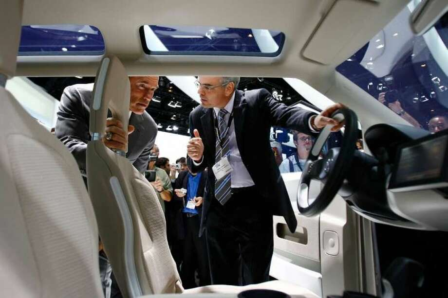 Jacoby and  Schwarzenegger inspect the interior of a fuel-cell powered concept car called space up! Blue during the two-day media preview of the Los Angeles Auto Show on November 15, 2007. Photo: David Mcnew, Getty Images
