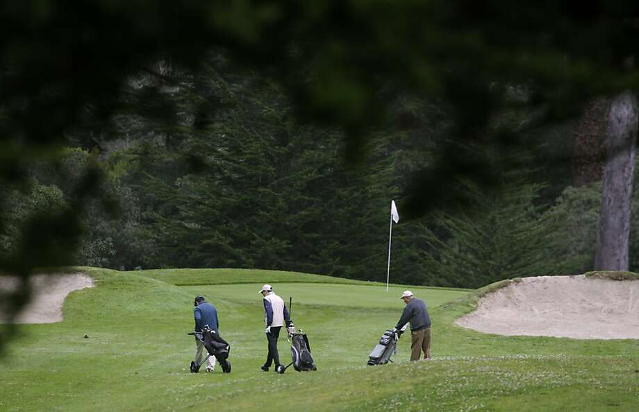 A threesome approaches a green at the Golden Gate Park golf course in San Francisco, Calif. on Thursday, Aug. 1, 2013. Tee times may be hard to come by after the First Tee organization takes over in the Fall. Photo: Paul Chinn, The Chronicle