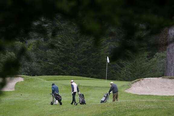 A threesome approaches a green at the Golden Gate Park golf course in San Francisco, Calif. on Thursday, Aug. 1, 2013. Tee times may be hard to come by after the First Tee organization takes over in the Fall.