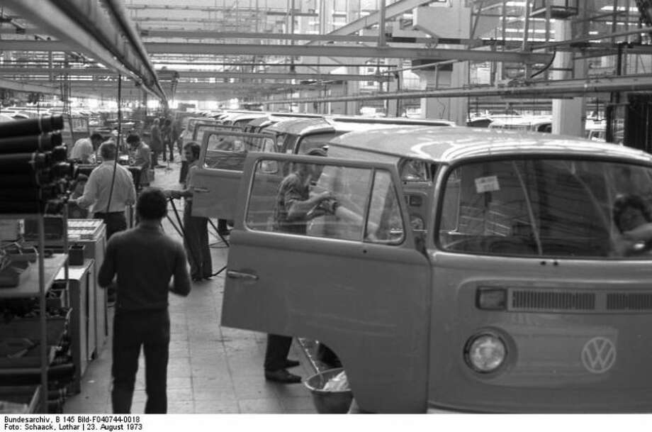 Assembly line workers apply finishing touches on Volkswagen Type 2 vans at VW Autowerks in Hannover on Aug 23, 1973. Photo: Lothar Schaak, Wikimedia Commons
