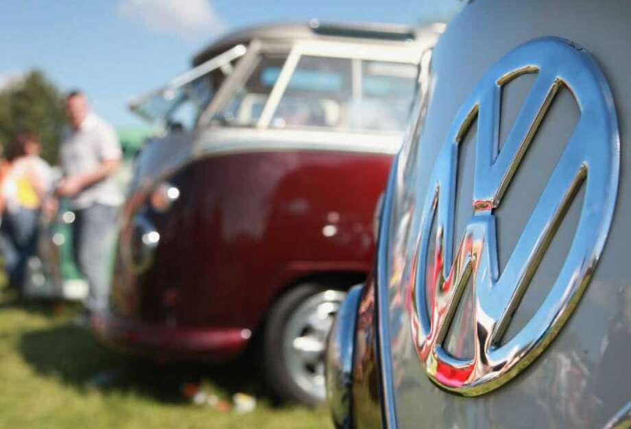 Type 2 Volkswagen vans line up for display at the 2009 Vanfest at the Three Counties Showground on September 13, 2009 in Malvern Wells, England. The annual event which started in 1994, attracted over 8,000 VW vehicles to what became the world's largest gathering of Volkswagen campervan enthusiasts. It has since been renamed Busfest and according to their website has become the ''world's largest international busfest event for owners, lovers and enthusiasts of Volkswagen Transporter Van's.'' Photo: Matt Cardy, Getty Images