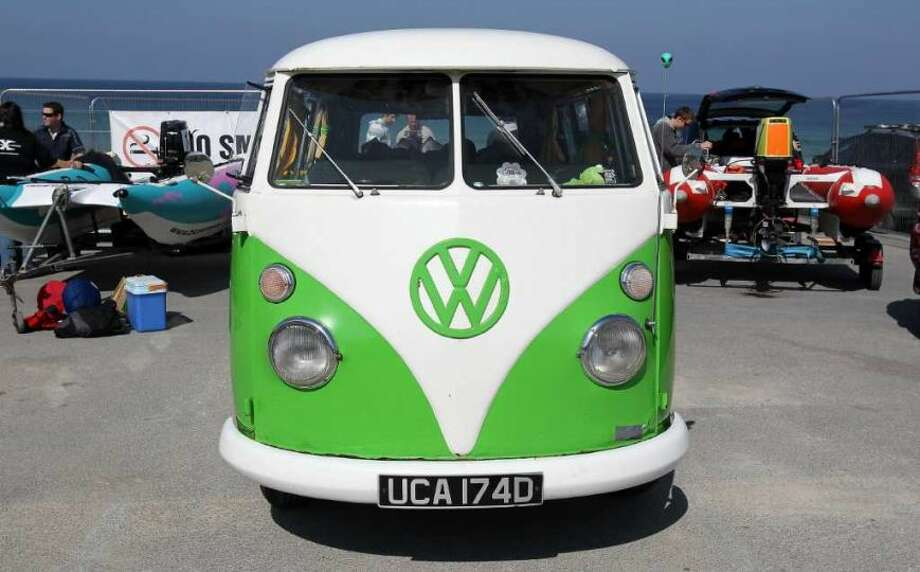 A classic Volkswagen camper van is parked in the Zapcat power boat team area as they are prepared for a practice race at Fistral Beach on April 23, 2010 in Newquay, England. Photo: Matt Cardy, Getty Images