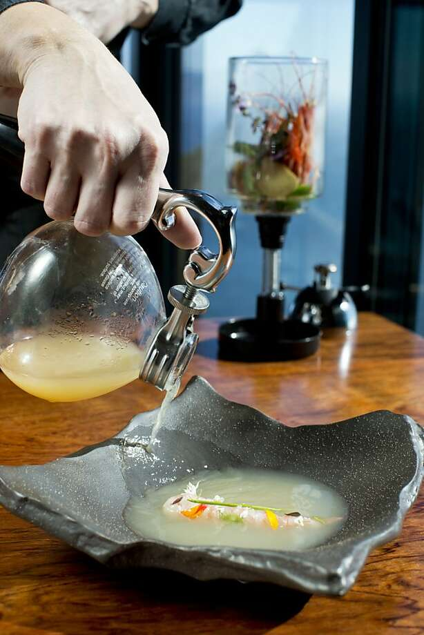 A server pours subtly flavored broth over wild spot prawn at the Sierra Mar restaurant in Big Sur, which has a striking view of the Pacific Ocean. Photo: Jason Henry, Special To The Chronicle